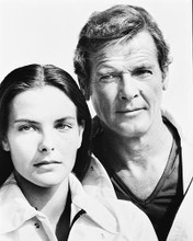 This is an image of 171456 Roger Moore & Carole Bouquet Photograph & Poster