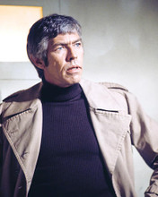 This is an image of 283104 James Coburn Photograph & Poster