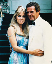 This is an image of 249911 Roger Moore & Tanya Roberts Photograph & Poster