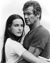 This is an image of Prints & Posters of Roger Moore and Carole Bouquet 104593