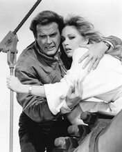 This is an image of Prints & Posters of Roger Moore and Tanya Roberts 104656