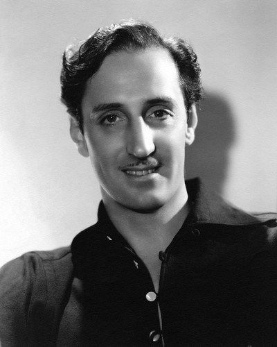 This is an image of Photograph & Poster of Basil Rathbone 101340