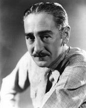 This is an image of Photograph & Poster of Adolphe Menjou 101444