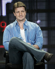 This is an image of 281789 Nathan Fillion Photograph & Poster