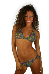 Tan through string bikini bottom with double tie sides in green Heat print.