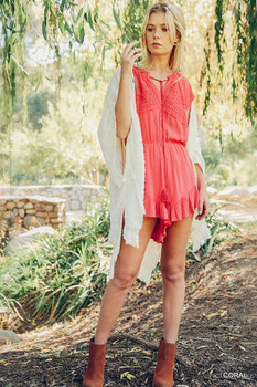 R7173 UMGEE Bohemian Cowgirl Ruffle Hem Tassel Tie Romper with Cinched Waist & Lace Details Coral