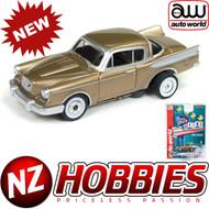 AUTO WORLD THUNDERJET ULTRA G R22 1957 STUDEBAKER HAWK (GOLD) HO SCALE SLOT CAR