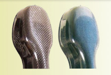 Exterior detail of blue and black carbon fiber cello cases.  This picture shows the top (scroll end) of the case.