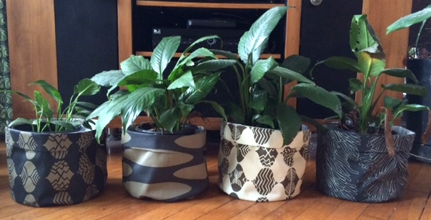 We have a lot of plants in our house and I wanted to make the generic  looking pots a little more appealing. I used these 4 coordinating home  decor fabrics ...