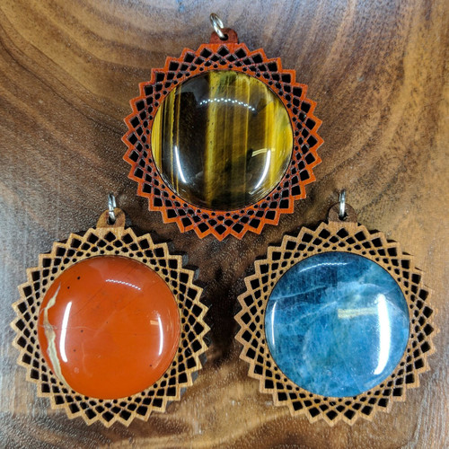 Top: Padauk with Tigerseye, Bottom Left: Cherry with Flame Jasper, Bottom Right: Walnut with Apatite
