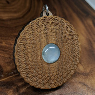 Flower of Life Phi Vortex Hardwood Pendant in Walnut with 12mm White Moonstone