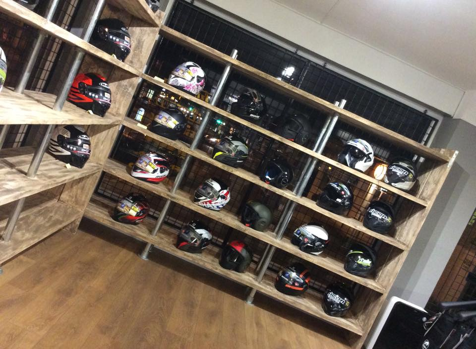 Motorcycle helmet display at Bolt Bikes shop, Bexhill
