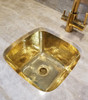 Installed hammered brass sink in shiny brass