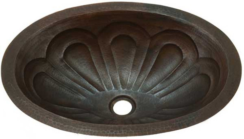 Copper oval sink with flower petal design.