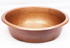 Small hammered copper pedicure spa foot soak bowl.