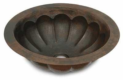Round medium sized copper sink with pumpkin design