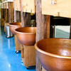Awesome Spa with large hammered copper spa pedicure bowls.