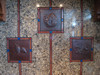Hammered Copper Tile with Pine cone, double aspen leaf and acorn with leaves designs installed over stove top