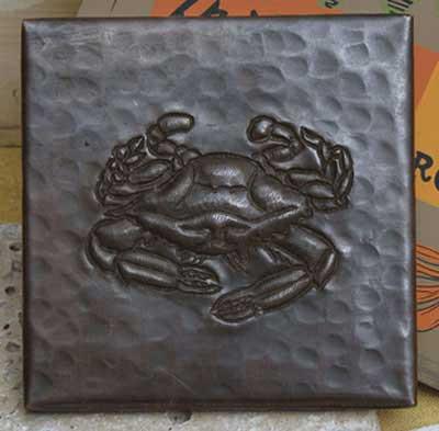 Crab design on hammered copper tile
