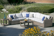 The sectional pictured is a four piece sectional with a curved corner chair and an armless chair. Other pictured items sold separately.