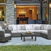 Photo features a four piece sectional, adding an armless chair