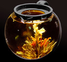 Jasmine phoenix blooming tea in a glass teapot ##for 1 blooming tea (makes at least one 6-cup pot)##