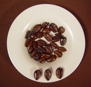Liberica beans have a unique crescent shape and are larger than Arabica
