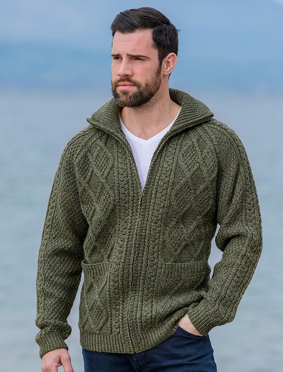 "This men's sweater by Hana Jason is knit sideways and features linen stitch on collar, cuffs, and yoke. Elbow-length sleeves you might want to knit longer. 40 (42, 44, 46, 48)"" chest circumference."