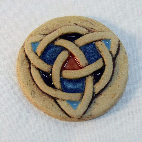Trinity Brooch made from a white stoneware clay, coloured glazes and oxide. Piece comes displayed on a product card.