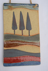 Summer Plaque made from a textured stoneware clay, coloured glazes and oxide.
