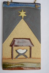 Nativity Plaque made from a textured stoneware clay, coloured glazes and oxide.