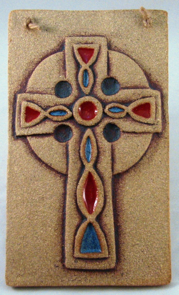 Celtic Cross Plaque made from a textured stoneware clay, coloured glazes and oxide.