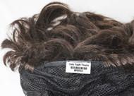 Tag Sewn into wig cap.