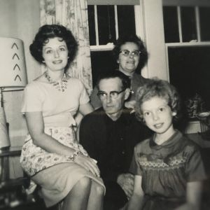 1960s Family with the mom wearing a half apron