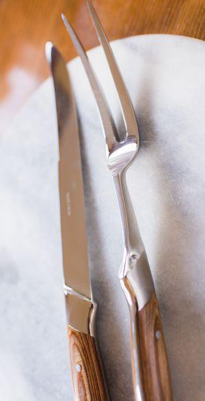 Vintage carving knife and fork on vintage marble cutting board
