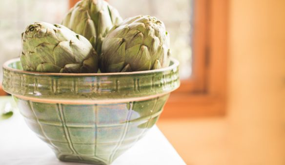 Vintage green stoneware bowl with artichokes