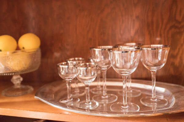Vintage champagne coupes with silver rims on vintage silver tray