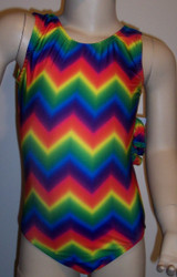Bold gymnastics leotard in a primary colored chevron spandex. Available in tank or racer back styles. Free scrunchie is included as always!