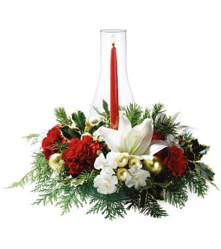 Lovely centerpiece with white lilies and red carnations centered with a globe and candle