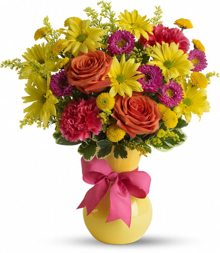 Think bold and beautiful with this array of yellow daisies, orange roses and vibrant pink carnations.