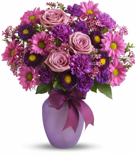 Know someone you love to make laugh? Someone you love to laugh with? Someone who could use a laugh? Someone who fits all of the above? Well, this beautiful arrangement has charms that extend way beyond its blossoms.