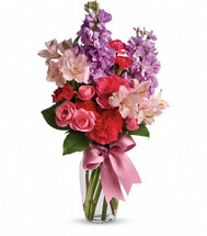 Pink spray roses, light pink alstroemeria, hot pink miniature carnations, lavender stock and salal are delivered in a charming vase that comes with its own pink satin ribbon. When you come across something this lovely at this price, you've got to jump on it!