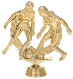 gold trophy with women soccer players kicking a ball