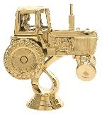 trophy with a gold tractor figure