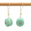 almond macaron earrings by inedible jewelry