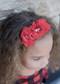 Chiffon Flower Gold Glitter Headband in red.