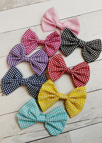 Classic gingham check fabric bows with an alligator clip backing.