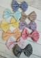 Soft classic seersucker like striped fabric hair bows with alligator clip backings.