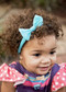 Soft nylon headband with a nylon single looped bow. Perfect for newborns and infants but stretchy enough to fit most.