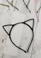 Fabric wrapped metal cat ear headband in cute feline colors that girls will love! One size, fits most girls.